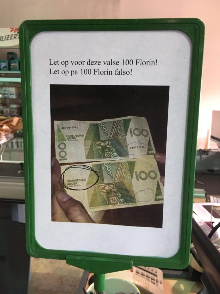 Watch out for false 100 Aruban Guilder bills.